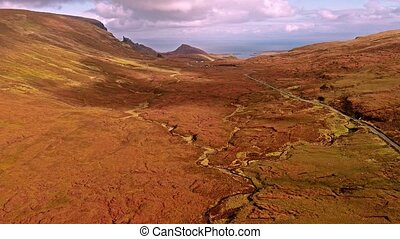 Flying over the mountain pass road on the top of Quiraing...