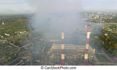 flying over the pipes of the plant from which the smoke...