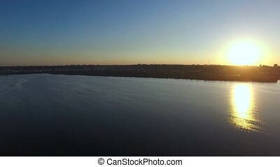 Flying Over The River at Sunset. Aerial Survey
