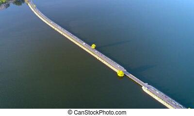 Flying over the river dam. Aerial camera shot. Ukraine.