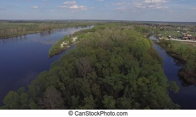 Flying over the river Desna near Kiev, Ukraine. Aerial view