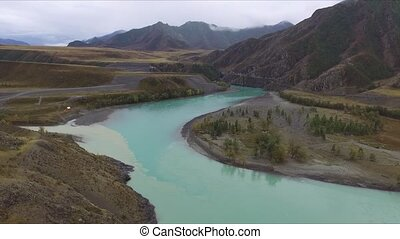 Flying over the river in the Altai