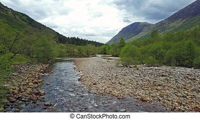 Flying over the river Nevis south of the famous Ben Nevis,...