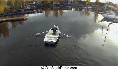 flying over the rowing boat - rowing boat aerial view camera...