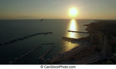 Flying over the sea and quay at sunrise, Greece - Aerial...