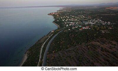 Flying over the sea and shoreline of Trikorfo Beach, Greece...