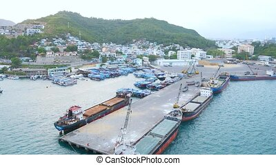 Flying over the small dock and moored boats in Nha Trang bay, Vietnam