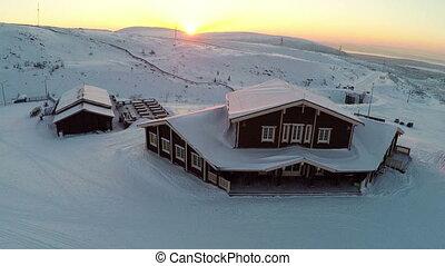 Flying over the winter ski centre at sunset