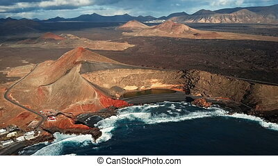 Flying over Volcanic Lake El Golfo, Lanzarote, Canary...