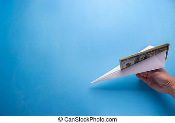 Flying paper plane with dollar banknote