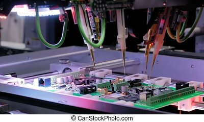 Automated technology, industrial, robotic, electronic, production, manufacturing concept. Automation machine equipment for quality testing of printed circuit boards - flying probe test - close up