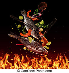 Flying raw sea bream fish above grill flames, isolated on black background. Concept of flying food, very high resolution image