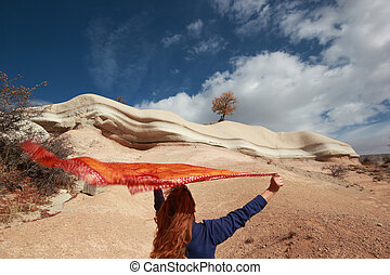 flying scarf and woman in nature