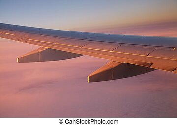 Flying - Sunrise view from an aircraft - Never forget to...