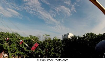 Flying swing attraction in the amusement park