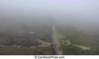 Flying through dense fog at Glengad mountain at Malin in County Donegal - Ireland.