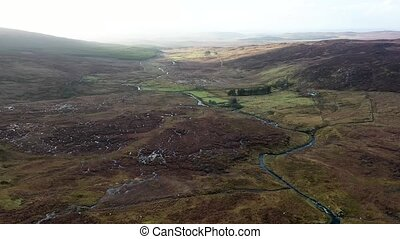 Flying through the bluestack mountains above the Owentocker River in Donegal - Ireland