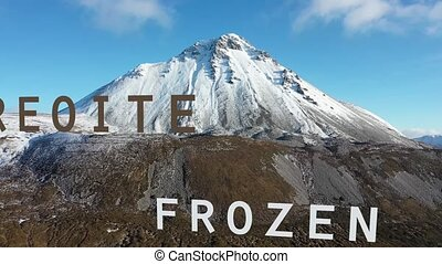 Flying through the letter Frozen in Irish and English towards Errigal Mountain in Ireland