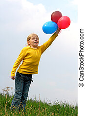 Flying to heaven  - Little girl playing with balloons