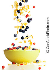 Flying to the bowl corn flakes with berries