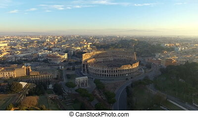flying towards Colosseum also known as Coliseum or Flavian...