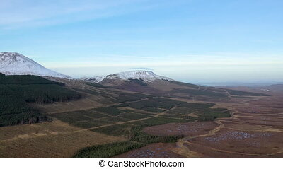 Flying towards Crocknalaragagh and Muckish Mountain next to Mount Errigal, the highest mountain in Donegal - Ireland