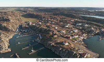 Flying Towards Rural Coastal Village and Empty Marina, Aerial . High quality 4k footage