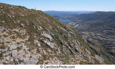 Flying towards Sanabria Lake - Aerial view of canyon and...