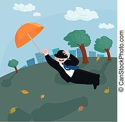 Flying umbrella man - An orange umbrella lifts a man off the...
