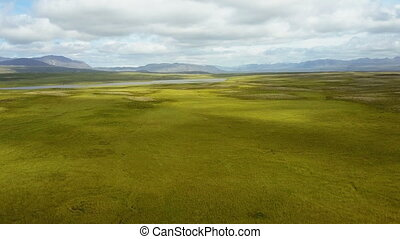 Flying up over lush summer landscape at Iceland - Camera...