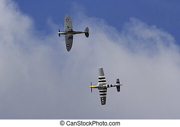 flying warriors - Spitfire and P-51 Mustang during flying...