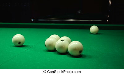 Flying white ball on a billiard table