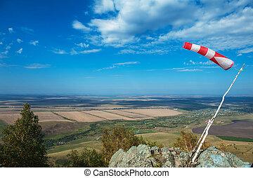 Flying windsock wind vane on mountine backgound, Check wind...