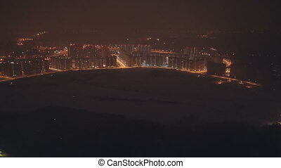 Flying with a place - window view of a city in the night slow motion from 50 fps
