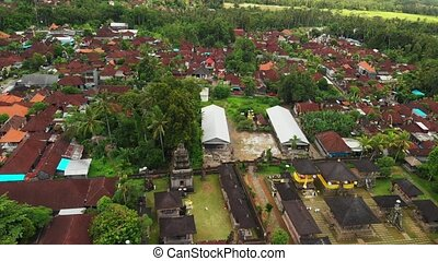 Flying with drone over balinese traditional temple. 4K...
