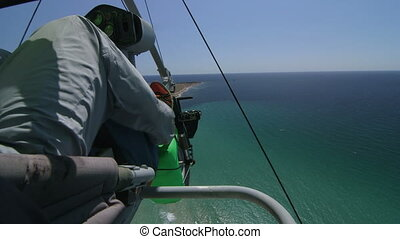 Flying with hang glider - Aerial view of seashore from hang...