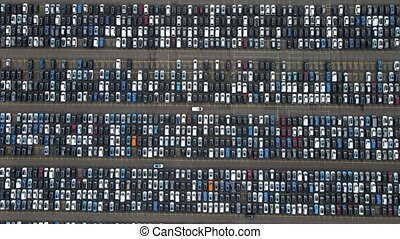 Flyover drone view top down on parked cars ready for shipping distribution