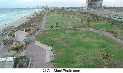 Flyover northern HaTsuk beach park of Tel Aviv shot clip