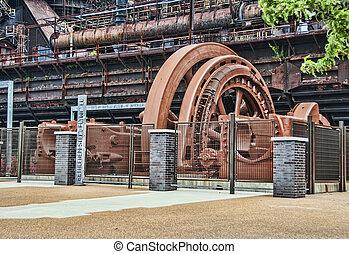 Flywheel - A very large steel flywheel at an abandoned steel...