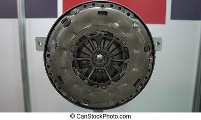 Flywheel of car engine repairs at service station internal parts of machine vehicle motor camera movement