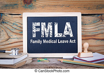 fmla, family medical leave act. Chalkboard on a wooden ...