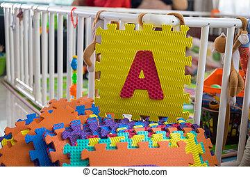 Foam alphabet puzzle pieces, A