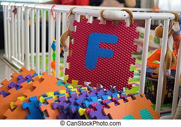 Foam alphabet puzzle pieces, F