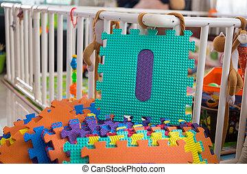 Foam alphabet puzzle pieces, I