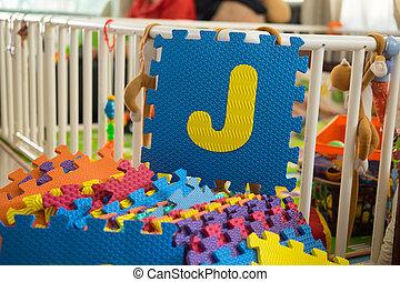 Foam alphabet puzzle pieces, J