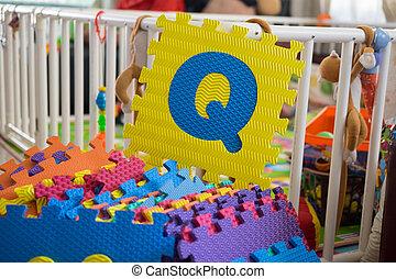 Foam alphabet puzzle pieces, Q