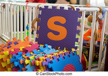 Foam alphabet puzzle pieces, S