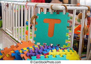 Foam alphabet puzzle pieces, T