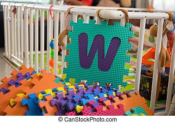 Foam alphabet puzzle pieces, W