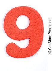 The digit nine in foam material.